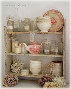 Display of Vintage Bottles and Red Transfer Dishes in Vintage Shelf