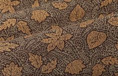 Forest Paisley Brown Interior Design Fabric is a cotton/linen blend made in Switzerland. The fanciful pattern combines a swirling weave with falling leaves, so this discount fabric is sure to bring movement to interior designs. Offeredat a 65% discount, this high-quality, design-center upholstery is only $40 per yard at FabricSeen.com.