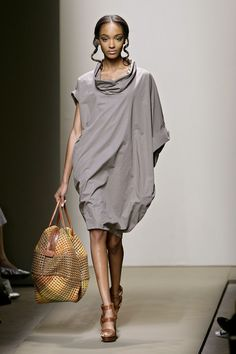 Bottega Veneta...so if i had to wear a bag...it would be like this but ad gold jewelry