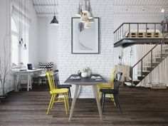 The next loft is a Scandinavian style design from the heart of Prague in the Czech Republic. White washes over the home from its painted brick accent walls to its exposed ceiling beams.  This particular loft does not shy away from design trends either. A few pops of neon yellow create a playful contrast with chevron stripes. And what hip loft design would be complete without some faux taxidermy.
