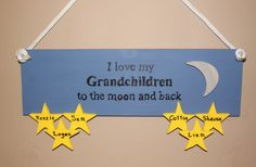 """I love my Grandchildren to the moon and back sign measures 15"""" x 5.5"""". This sign is perfect for any Grandparent. Add as many names as you would like on to the stars. Each piece is hand drawn, hand cut and hand painted."""