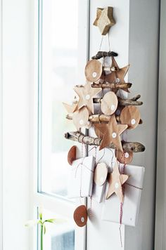 Advent calender - driftwood sticks with sewed paper - inside for each day an activity that we will do together, and on Sundays there is a common gift to the children - homecity linn