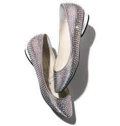 "Avon: mark Glam and Go Flat Shoe. Covered in iridescent rhinestones, these almond-toe pewter satin flats open up a rainbow of possibilities, outfit-wise! 1"" mirrored silver heel. Available in full sizes only; half sizes order up."