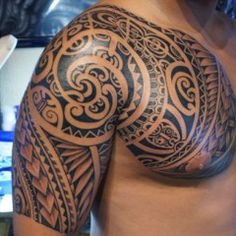 swirly polynesian chest and half sleeve tattoo polynesian tattoo