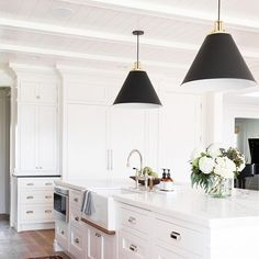 """""""A classic foundation with modern touches."""" Shea & Syd of @studiomcgee used our Butte Cone pendants & Hexagonal Bin pulls in this kitchen remodel to make their client's vision come true. Link in profile to see the before & after photos of this whole home remodel. Photo by @kateosborne  #myonepiece #kitchenremodel #windsongproject #pendantlighting #mcgeeandco"""