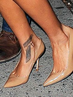 Rihanna covered up the music notes tattoo when she got this large . Rihanna Ankle Tattoo, Rihanna Cover, Tribal Tattoos, Heart Tattoos, Note Tattoo, Tattoo Inspiration, Stiletto Heels, Kitten Heels, Cover Up