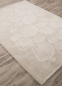 Seashell Coastal Tides Area Rug - Chase away the winter blues and warm up any room in your home with this new seashore rug!