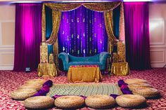 Bold Gem Tones for the Mehndi Sangeet Dholki Stage Backdrop