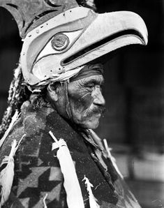 This is a wonderful photograph. Northwest Native American, I think so anyway, looking at the mask he's wearing.