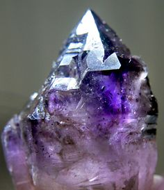 Perfect Amethyst Brandberg Elestial. Namibia.   Smoky Quartz and Amethyst within a multi-MULTI-terminated (trying to make points all over it's body) Quartz crystal, showing splendid triagulation and wonderful colours inside.  Also full of Lepidochrosite flecks.  #pixiecrystals photographed by me  :)