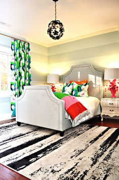 a pop color guest room. i love the mix of prints!