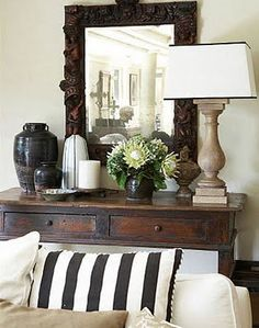 The rustic look is eye catching:) Everything on this console table just sings in harmony:)
