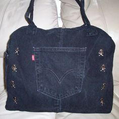 Up-cycled black Levi's denim jeans, skull studs and corded bag handles