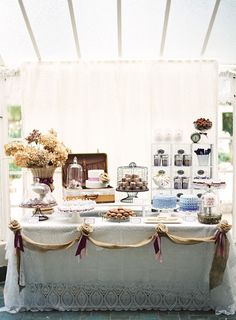 Another dessert bar - i like the white tablecloth and burlap scalloped decoration