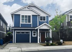 COASTAL COOL | Presented by Spray-Net | Spray-Net's breezy, on-trend Coastal Blue paint with contrasting white trim takes this two-storey home with Hardie siding from drab to dynamite. Not sure which hues will make your home's architectural features pop? Spray-Net has a wide array of eye-catching exterior paint colours to choose from. From Cashmere to River Rock to Sandalwood, you'll find the perfect hue for you.