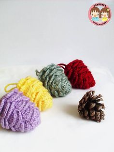 Ravelry: Colorful Pine Cone for Decoration pattern by May Ahmaymet. This may fit into the woodsy lodge theme if you did the right colors