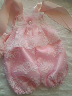 Newborn Baby Girls White Lace and Pink Bubble Romper set Coming home outfit Its made of a beautiful White lace and pink Bubble Romper set... so Adorable perfect for Summer for baby. Comes with matching headband. This cute little romper is made of high end lace and satin fabric. It