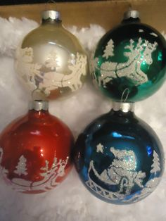 Vintage glass ornaments (4) with glittery designs on Santa & Reindeer