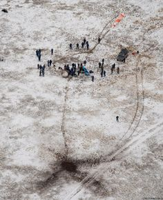 Support personnel are seen at the landing site of Soyuz TMA-13M spacecraft in a remote area near the town of Arkalyk, Kazakhstan
