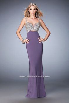 All heads will turn when you walk in in this gown. Stand out in this jersey gown with a plunging neckline and slight midriff cutout. The bodice and straps are encrusted with sparkling crystal stones.