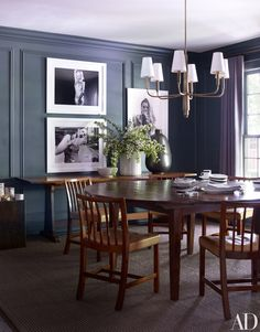 Edgy photographs of Kate Moss add punch to the leanly furnished dining room | archdigest.com