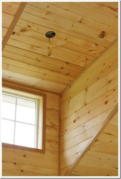 Unfinished pine walls and ceiling