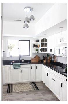 White Cabinets White Countertops, Black Kitchen Countertops, Black Kitchen Cabinets, Black Kitchens, Home Kitchens, Countertop Paint, Dream Kitchens, Gray Cabinets, Kitchen Cabinets Black And White