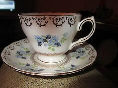 COLCLOUGH  CHINA  TEA CUP AND SAUCER WHITE WITH GOLD TRIM