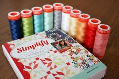 Rocking retro goodness with this 45 adapter cushion designed and made by Amy Gunson from @Brenda Franklin D Skirt for the Sew Mama Sew mini challenge using @Laura Lorenzetti Thimble Thimble Blossoms by Camille Roskelley #Aurifil collection.  To see more please visit http://badskirt.blogspot.com.au/2013/12/aurifil-thread-packs-give-them-spin.html