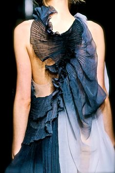 Dress back with manipulated fabric textures; exquisite fashion details