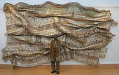 """El Anatsui - from patternbank: """"El Anatsui's amazing installations and wall sculptures need to be seen to be believed. Using thousands of aluminium bottle tops and other found materials such as wood and clay he moulds and shapes these magnificent pieces. Like vast folded, sculpted and pieced together fabrics that shimmer and sparkle, they tell cultural and economic stories of their past use."""""""