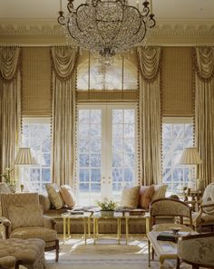 : Glorious Living Room Designed In Double Height Concept With Huge Italian Chandelier Above Yellow Tables