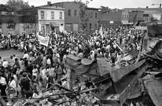 FILE: A procession of welfare mothers makes its way down 7th Street in the northwest section of Washington, May 12, 1968, moving past the rubble of a store burned during the April rioting following the assassination of Dr. Martin Luther King. (AP Photo/Harvey Georges)