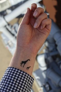 The perfect mother/child tat. I adore giraffes. I want this...just not sure about placement.