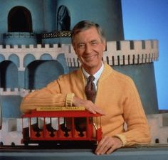 Mr. Rogers. Mr Rogers Neighborhood.  Loved him! I watched this show when I was little. So glad they used him as an inspiration for Daniel Tiger's neighborhood!