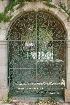 Green wrought iron gate in the city of Nicosia, North Cyprus.