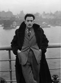 Salvador Dali stands on the deck of the S.S. Normandie as it docks in New York City, December 7, 1936 -