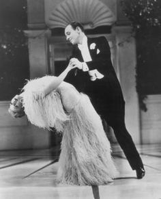 One of my favorite places is watching classic movies like this one, Top Hat. In this scene, Ginger Rogers has on the most beautiful dress and she moves like an dream.