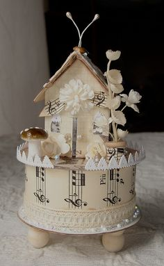Mini house on ribbon spool / would be so cute as a 'bird house' theme or 'fairy' theme...'winter/holiday' theme, too  : )