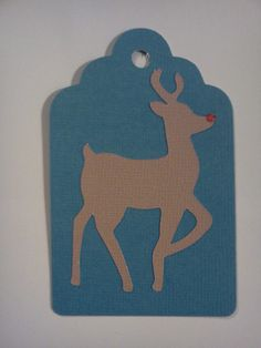 My home made gift tags.  Used a free SVG reindeer file.  Used Plantin SchoolBook Cricut cartridge Tag 1- 3.5 inches.  Then used puff paint for the nose.  The finished ones have names in the middle and I gave the reindeer an eye with a sharpie.
