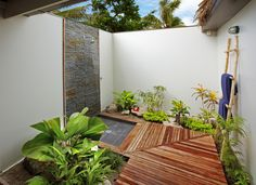 Glamorous Bathroom Outdoor Nature Shower Bath Design Ideas with Fresh Green Plant Decor and Stripe Woods Floor Nature Bathroom Design with G...