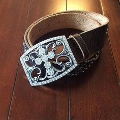 """GUESS Leather Belt with rhinestones and rivets Absolutely beautiful brown leather belt with bling! Pewter look buckle with cross design adorned with floral shapes and rhinestones. Belt has big rhinestones and rivets. Says size small but length to furthest hole is 34"""". Smallest 28"""". Worn once for show. No flaws or wear. All stones intact. Excellent condition. Width is 1.5"""". Guess Accessories Belts"""