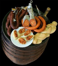 Embutidos de Extremadura....cool shot of cured chorizos etc with the porron and bread