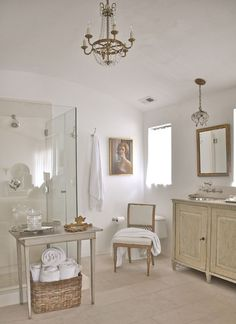 Soothing bathroom with pretty stuff in it - especially like the little bit of glam in the silver sinks