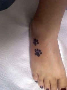 Dog footprints tattoo on foot. Find and save ideas about Dog footprints tattoo on foot on Tattoos Book. More than FREE TATTOOS Dog Tattoos, Cute Tattoos, Beautiful Tattoos, Body Art Tattoos, Print Tattoos, Tatoos, Ankle Tattoos, Footprint Tattoo, Get A Tattoo
