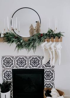 stocking stuffer ideas / christmas mantel decor modern boho white greenery mantel decor with pom pom stockings
