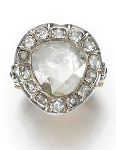 DIAMOND RING, 1820S The heart-shaped ring centring on a rose diamond within a frame and shoulders set with old mine and circular-cut diamonds,