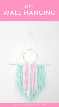Make this DIY wall hanging in 15 minutes or less. All you need is yarn, dowel, and scissors. Looks amazing as wall art or in a gallery wall! Clever Diy, Easy Diy, Simple Diy, Yarn Crafts, Diy And Crafts, Fabric Crafts, Yarn Wall Hanging, Wall Hangings, Boho Stil