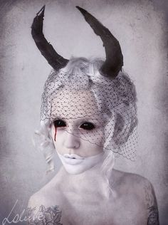 ooooooh, something definitely like this. I need eyes, horns and lots of white makeup. Not sure what to do with clothing, but probably something monotone