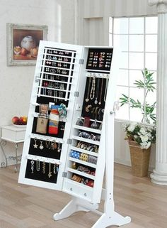 A standing mirror doubling as a jewelry case. I want!!!
